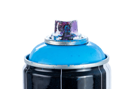Close-up of a blue spray paint can with used and painty nozzle, isolated on white background. Reklamní fotografie