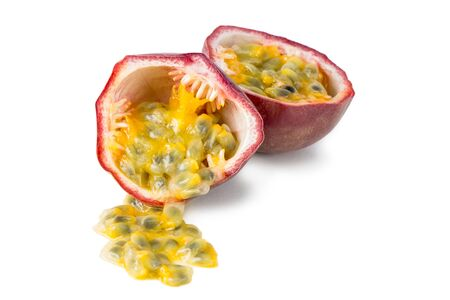 passiflora: Close-up of a split passion fruit passionfruit, purple granadilla Passiflora edulis isolated on white background. Stock Photo