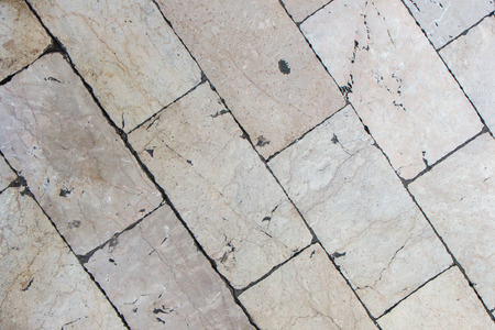 deteriorated: Close-up of a smooth paving at Stradun or Placa, the main street in Dubrovnik, Croatia. Viewed from above.