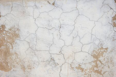 cracked wall: Close-up of a cracked and weathered concrete wall texture background.