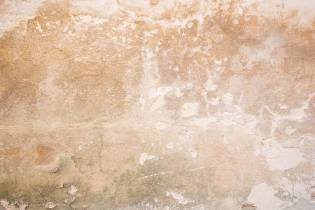 peeled off: Weathered and peeled off orange concrete wall texture background. Stock Photo