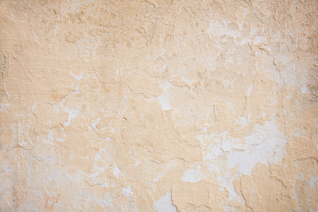 peeled off: Weathered and peeled off concrete wall texture background in peach color.