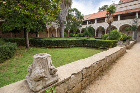 benedictine: Former Benedictine monasterys inner courtyard and garden at the Lokrum Island in Croatia. Stock Photo
