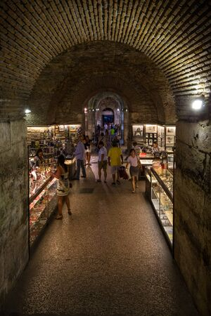 dimly: Dimly lit underground souvenir stall complex at the Diocletians Palace in Split, Croatia.