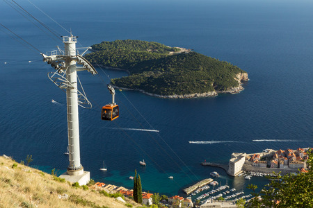 srd: View of a cable car and Lokrum Island in Dubrovnik, Croatia, viewed from Mount Srd.