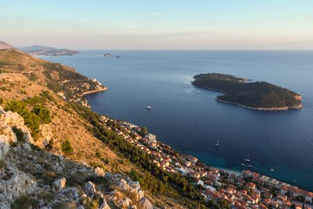 srd: Scenic view of coastline and Lokrum Island from the Mount Srd in Dubrovnik, Croatia at sunset.