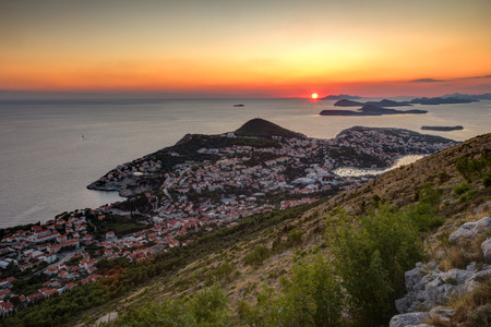 srd: Scenic view of city of Dubrovnik from the Mount Srd in Croatia at sunset.