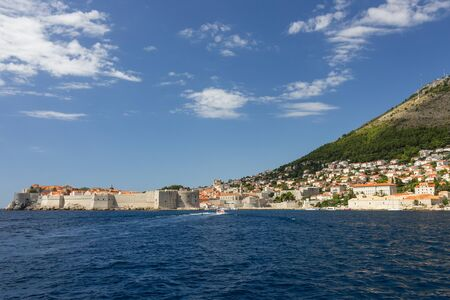 srd: View of the City Walls, city of Dubrovnik and Mount Srd from the sea in Croatia. Copy space.