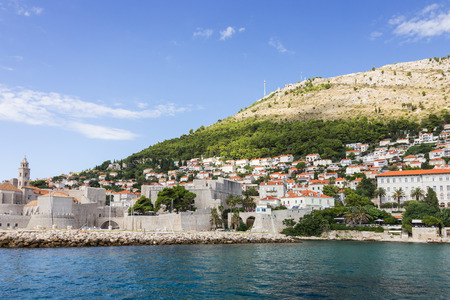 srd: View of the walled Old Town, buildings on the hillside and Mount Srd from the sea in Croatia.
