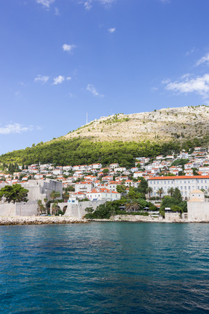 srd: View of buildings on the hillside and Mount Srd from the sea in Croatia. Copy space.