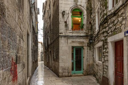 Narrow and empty alley or pedestrian street at the Diocletians Palace in Split, Croatia. Editorial