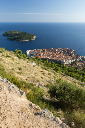 srd: View of a slope at the Mount Srd, the walled Old Town and Lokrum Island in Dubrovnik, Croatia from above.