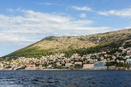 srd: View of buildings on the hillside and Mount Srd from the sea in Dubrovnik, Croatia. Copy space.