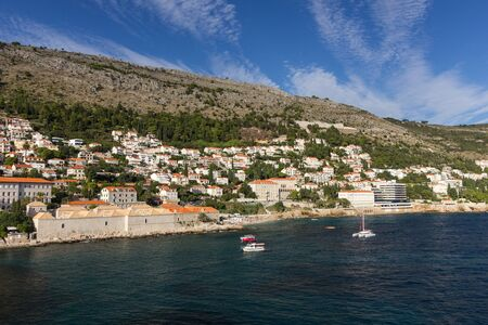 srd: View of buildings on the hillside and Mount Srd from the sea in Dubrovnik, Croatia.
