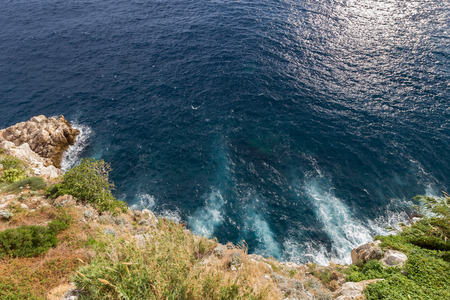 ocean: View of rocky coastline and deep blue ocean from above in Dubrovnik, Croatia. Stock Photo