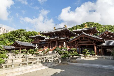 tang: Temple hall and Chinese garden at the Chi Lin Nunnery in Hong Kong, China. Traditional Chinese architecture in Tang Dynasty style.