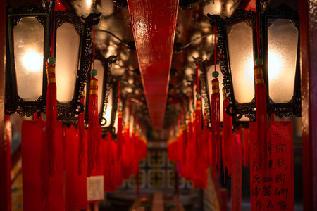 mo: Long row of lit lanterns hanging at the Man Mo Temple in Hong Kong, China. Viewed from the front. Editorial