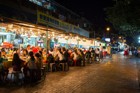 Crowded restaurant at the Cheung Chau Island in Hong Kong, China, at night. Editorial
