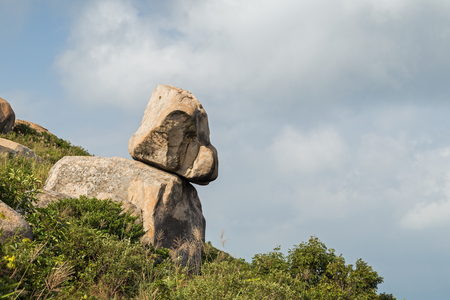 ling: Rock or boulder looking like a puppy at the Ling Kok Shan hill at the Lamma Island in Hong Kong, China. Stock Photo