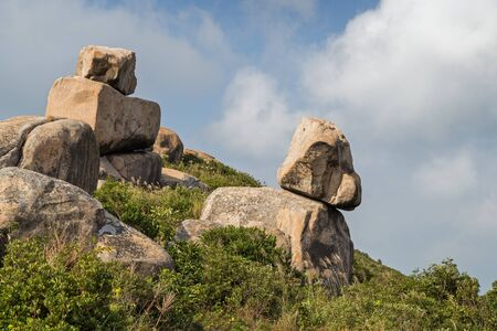 ling: Big rocks and boulders on top of the Ling Kok Shan hill at the Lamma Island in Hong Kong, China, one looking like a puppy.