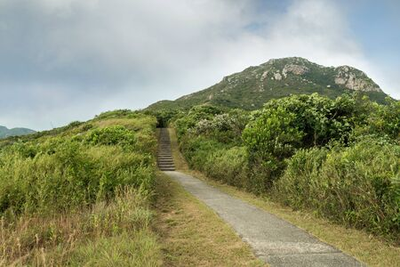 ling: Ling Kok Shan hill and paved footpath at the Lamma Island in Hong Kong, China. Stock Photo