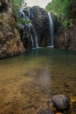 mound: Tai Tam Mound Waterfall, pond and a rock in Hong Kong, China.