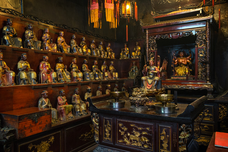 worship god: Many statues of Taoist deities Man Tai and Mo Tai inside the Man Mo Temple in Tai Po, Hong Kong, China.