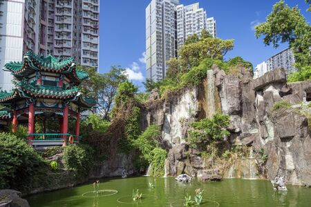 sin: View of pond and Hexagonal Pavilion at the Sik Sik Yuen Wong Tai Sin Temple in Hong Kong, China. Stock Photo