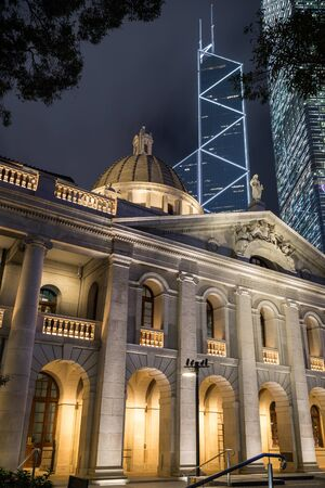 legislative: Court of Final Appeal Building or Legislative Council or Supreme Court in Central Hong Kong, China, at night.