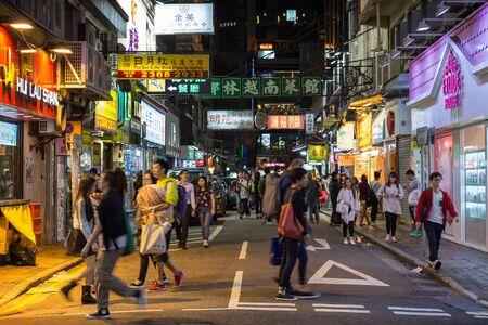 kowloon: Crowded street in Kowloon, Hong Kong, China, at night. Editorial