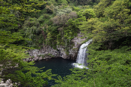 tier: Third tier of the Cheonjeyeon Falls on Jeju Island in South Korea viewed from above. Stock Photo