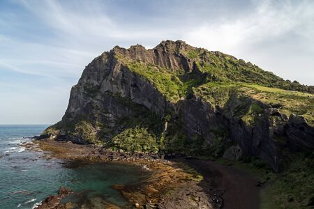 archetypal: View of Seongsan Ilchulbong (Sunrise Peak), archetypal tuff cone, on Jeju Island in South Korea.