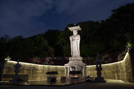 maitreya: Plaza and Mireuk Daebul statue (The Great Statue of Maitreya Buddha) at the Bongeunsa Temple in Gangnam, Seoul, South Korea at night. Editorial