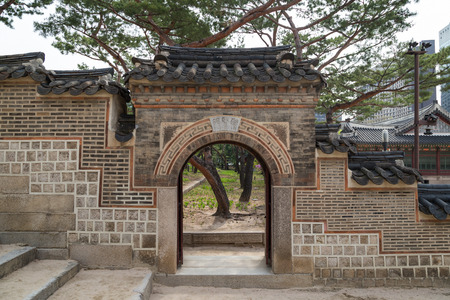 surrounding wall: Surrounding wall and gate at the Deoksugung Palace in Seoul, South Korea. Editorial