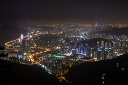 View of Busans skyline in South Korea from above at night. Stock Photo