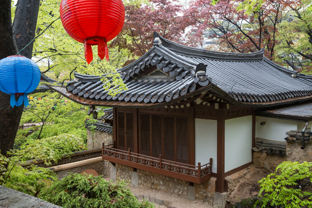 Gilsangheon - a wooden building, living quarters for master sunim (senior monks) and two lanterns at the Gilsangsa Temple in Seoul, South Korea.