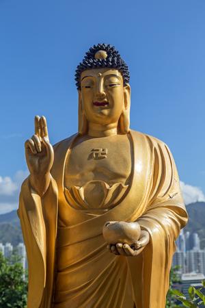 Closeup of a smiling Buddha statue at the Ten Thousand Buddhas Monastery (Man Fat Tsz) in Sha Tin (Shatin), Hong Kong, China.