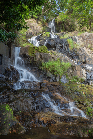 Low water flow at the lower fall of the Silvermine Waterfalls on the Lantau Island in Hong Kong, China.