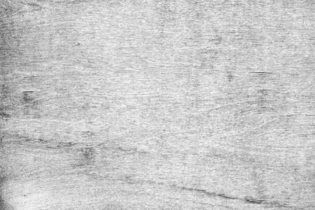 ply: Close-up of a cracked and weathered plywood texture background in black&white.