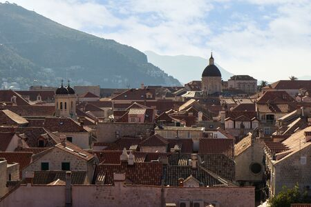 srd: View over buildings and red roofs of the historic Old Town and Mount Srd in Dubrovnik, Croatia.