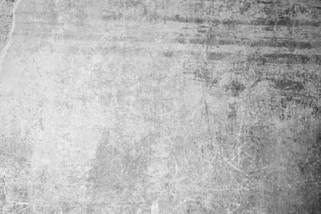 scraped: Weathered, aged and scratched concrete wall texture background with some vignetting. Stock Photo