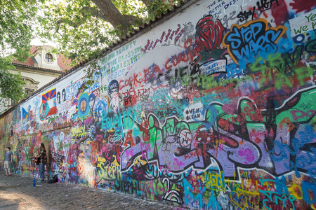 A Tourist And Busker At The John Lennon Wall (or Lennon Wall ...
