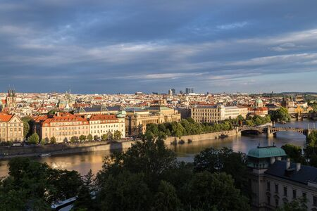 Old Town and beyond behind the Vltava River in Prague, Czech Republic, viewed slightly from above in the daytime.