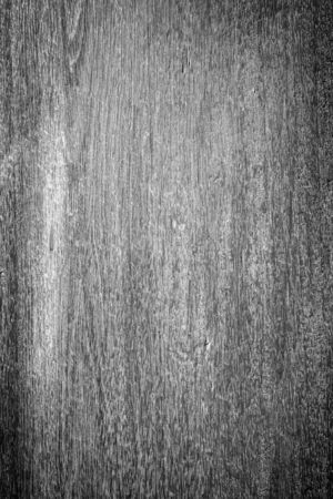 Close-up of an faded wooden board wall texture background with vignette in black and white.