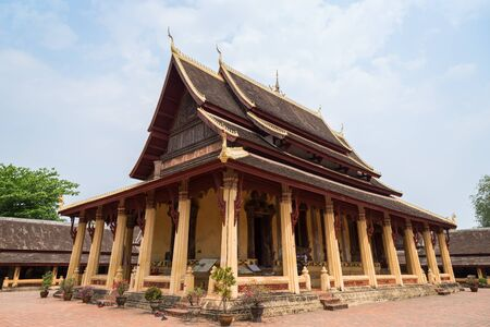 View of the Buddhist Wat Si Saket (Sisaket) temple in Vientiane, Laos, on a sunny day.