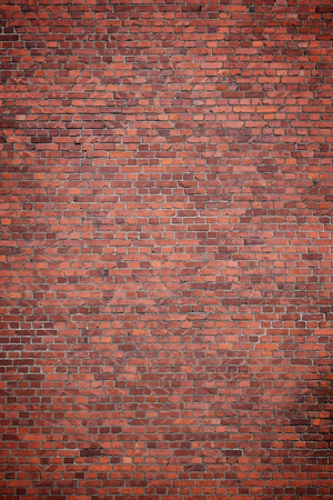 Big full frame background of detailed old red brick wall with vignette. Copy space.