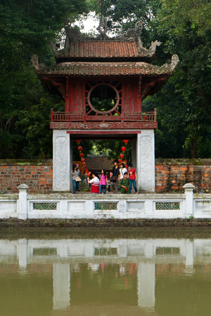 Tourists at the Temple of Literature (Van Mieu) in Hanoi, Vietnam. Its a Temple of Confucius and was built in 1070.
