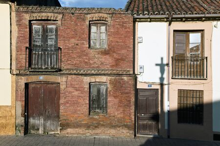 View of typical houses of northern Spain with a shadow reflection of a cruceiro photo