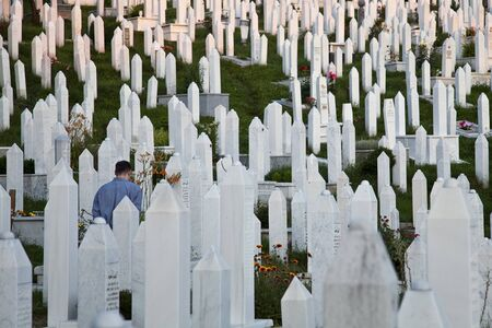 Man walking at the cemetery in Sarajevo photo