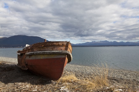 Boat run aground in a beach at fagnano lake, tierra del fuego, Argentina Stock Photo - 16826853